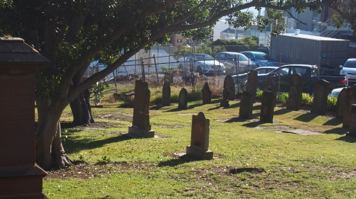 All that remains of the graveyard today - some headstones are so worn they are no longer legible.